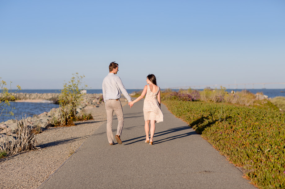 Coyote Point Marina engagement photo - walking by the water