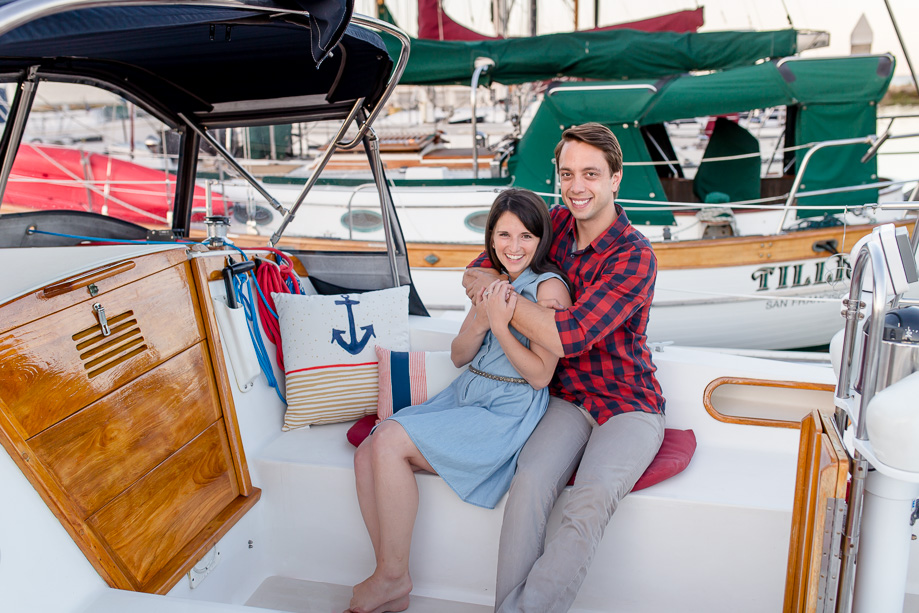 sitting inside a sailboat for couple portraits