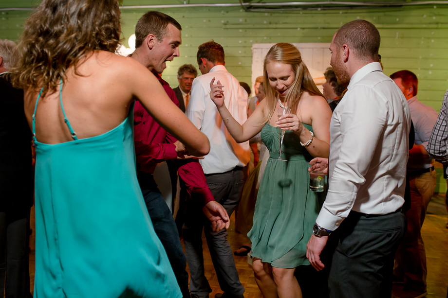groom's sister dancing with wedding guests