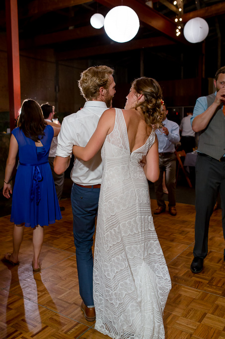 bride and groom having fun on the dance floor