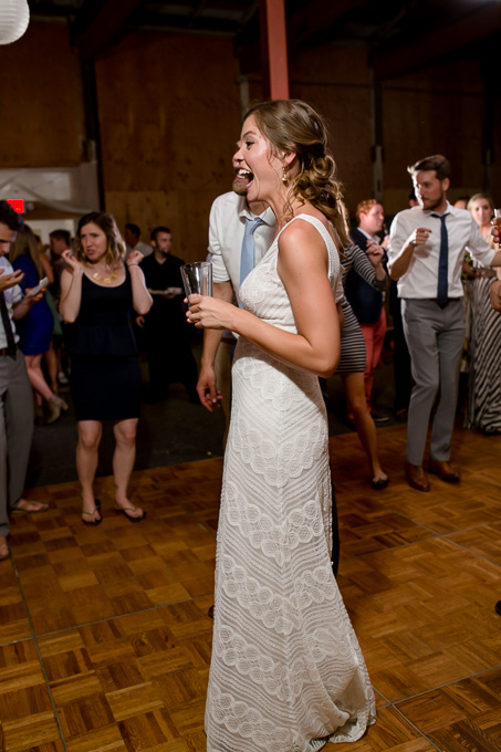 bride laughing during wedding reception