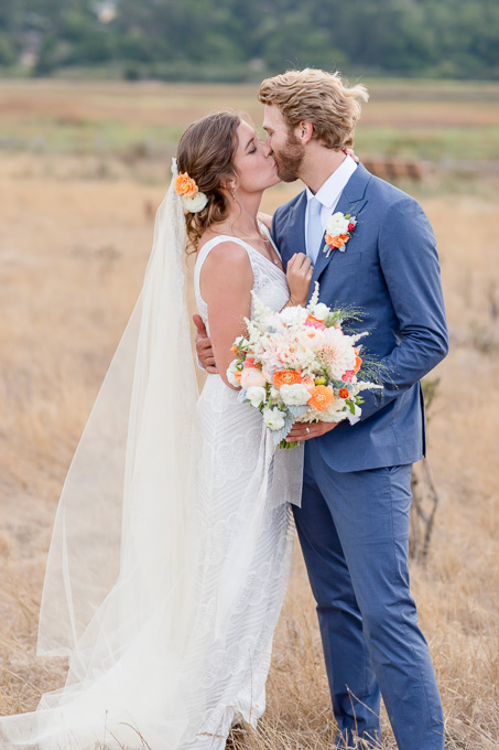 couple sunset portrait in an open field of wild flowers - Pacifica wedding photographer