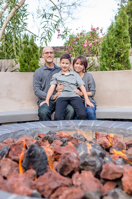 mother father son family photo in front of fire pit