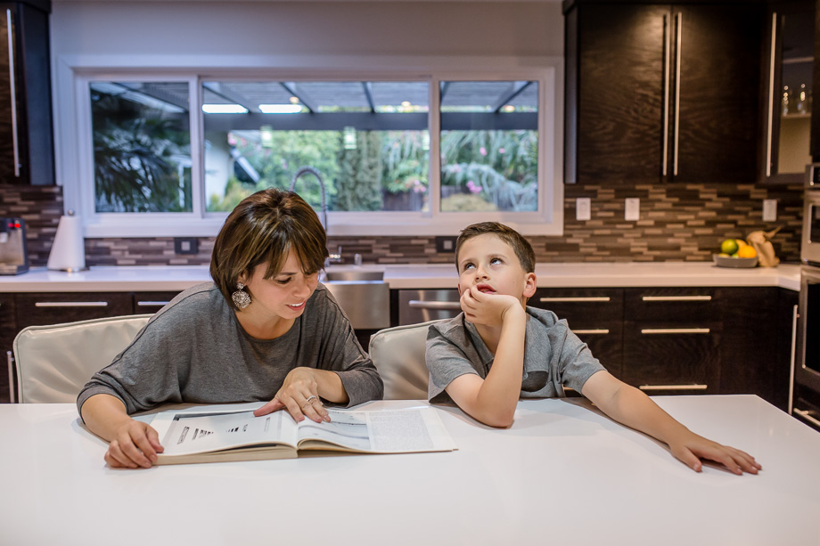 son looking bored of mom teaching him things