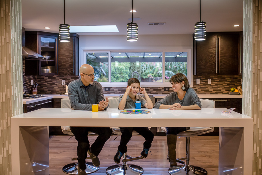 family sitting at kitchen table
