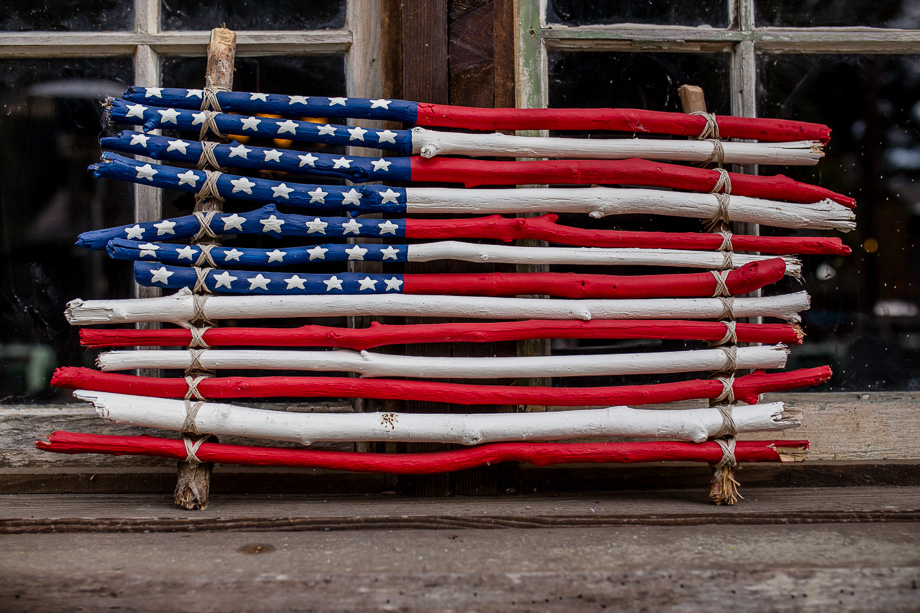 an american flag made of wood sticks