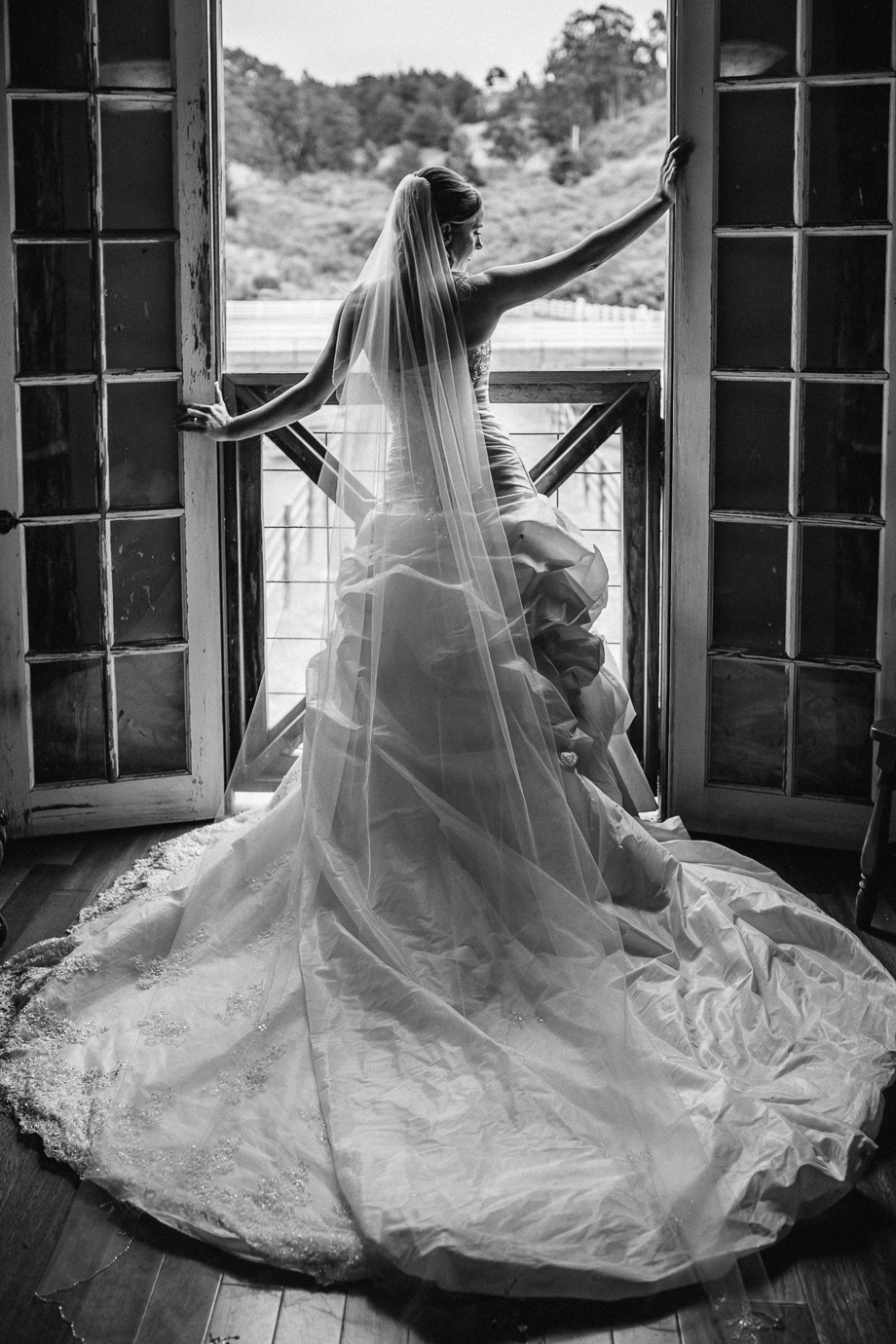 back of a stunning wedding gown - beautiful bridal portrait at long branch saloon and farms