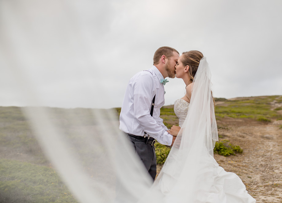 half moon bay wedding photo on a small hill