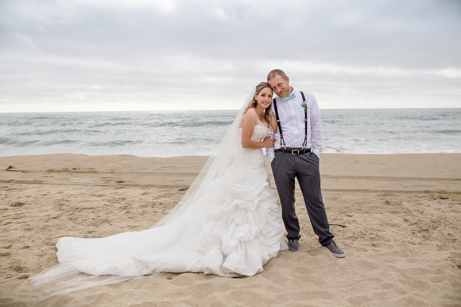 bride and groom portrait on a beach along highway one