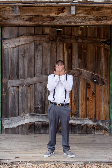 groom covering his face for the first look