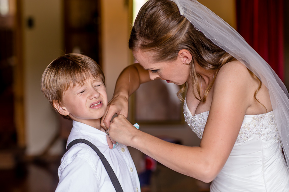 a funny photo of the bride and the ring bearer