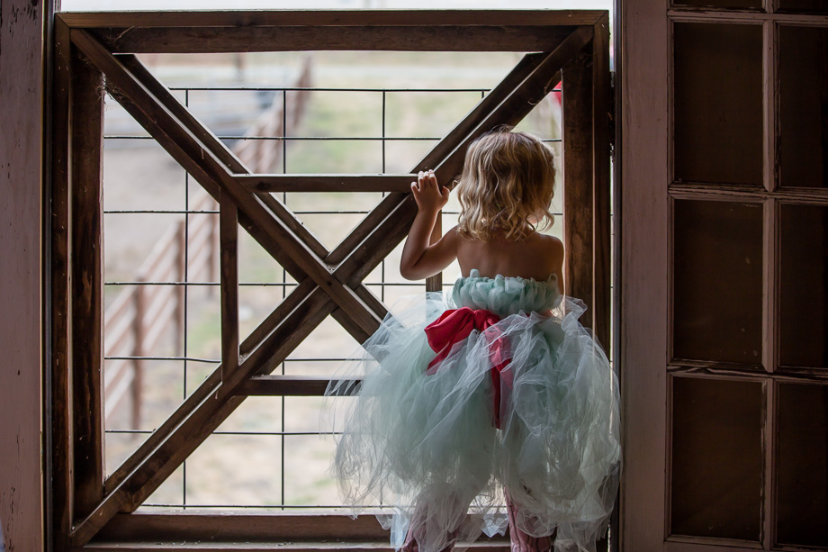 cute flower girl peeking out of the window