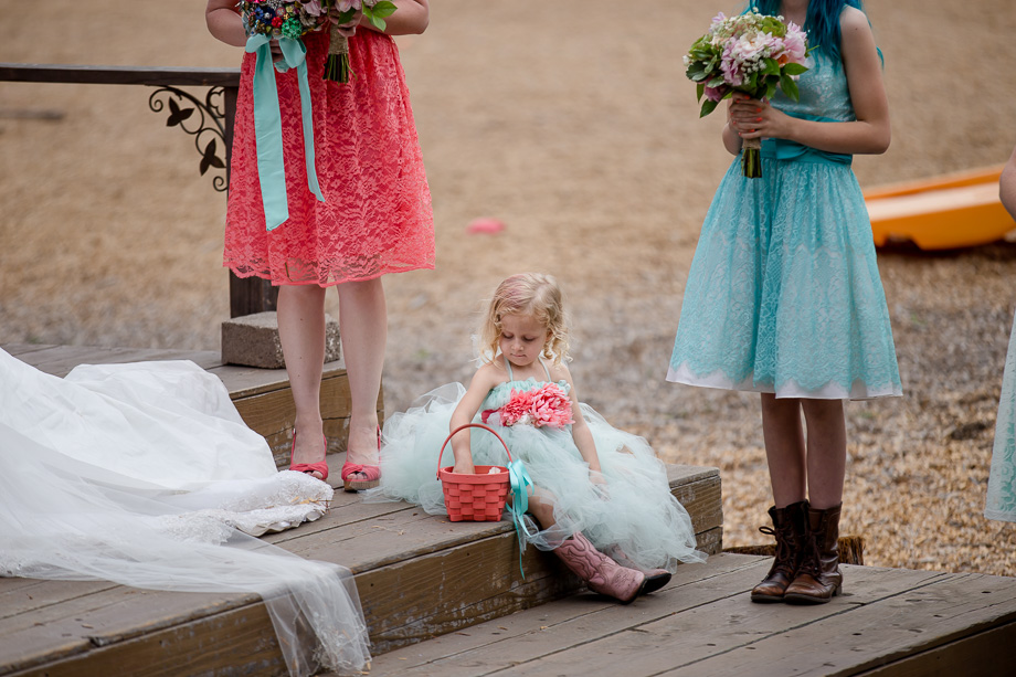 kids will be kids - adorable flower girl not paying attention at the ceremony