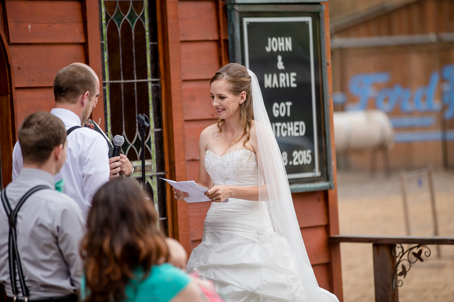 bride reading her handwritten vows