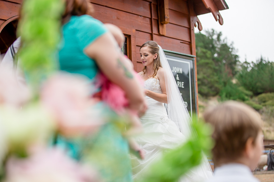 beautiful bride reading her vows in front of the red rustic barn chapel - half moon bay wedding photographer