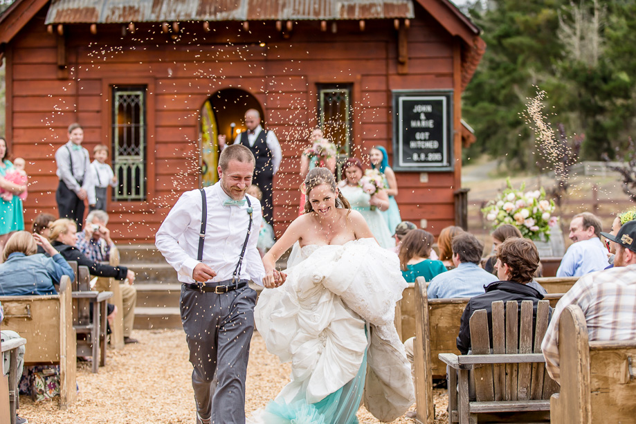 bride and groom running down the aisle as wild oats were thrown at them as blessings