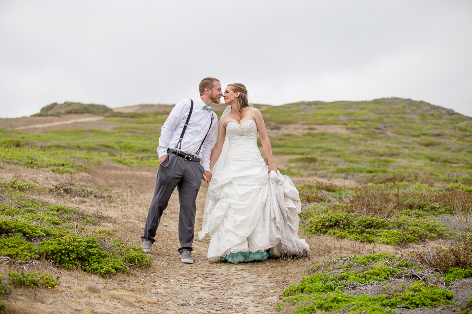 bride and groom portrait on a hill - half moon bay wedding