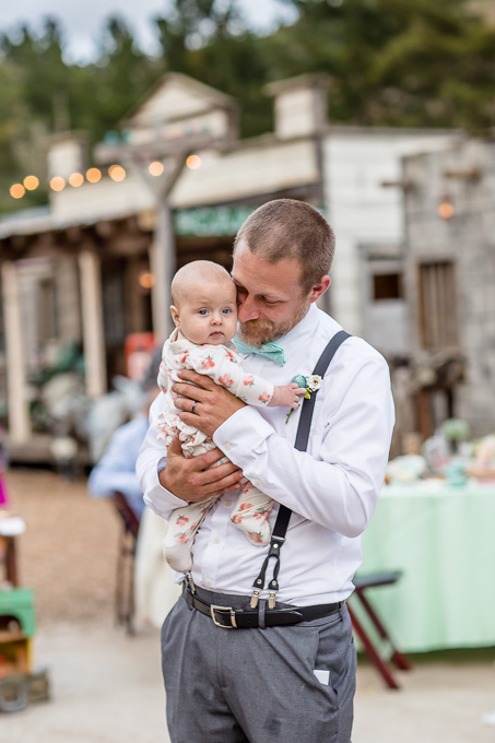 groom dancing with his little baby girl