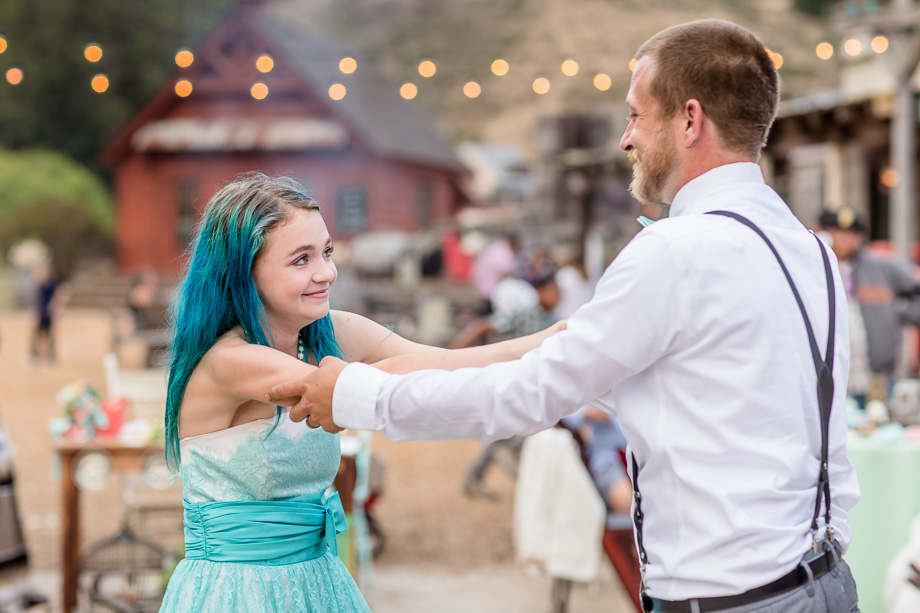 groom dancing with his teenage daughter