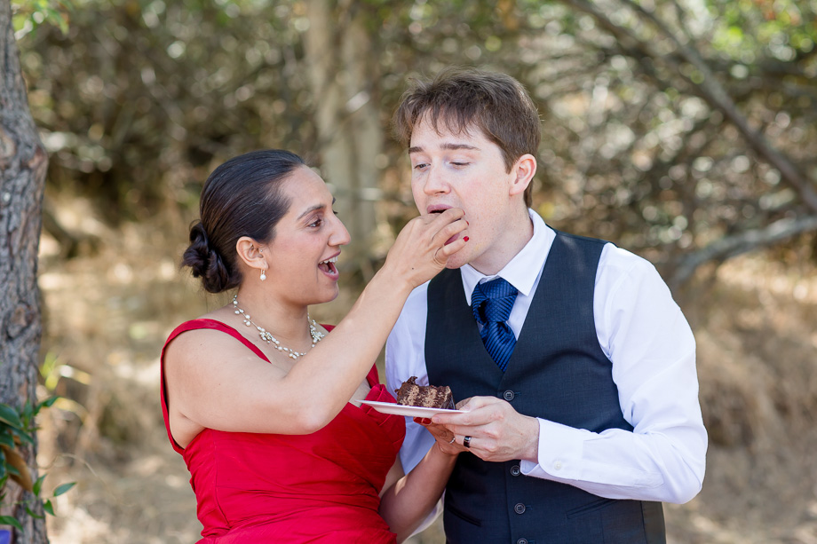 bride feeding the groom a piece of wedding cake