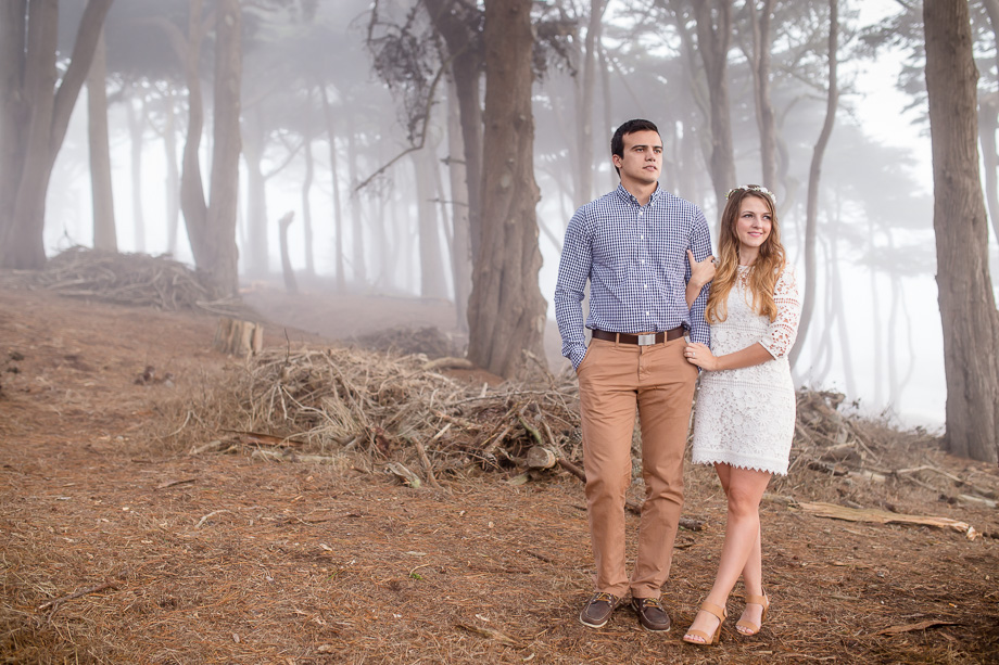 couple in foggy woods looking off into the distance