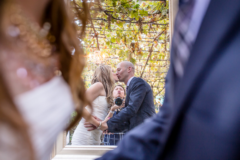 a funny photo in which the photographer photobombed the newlyweds