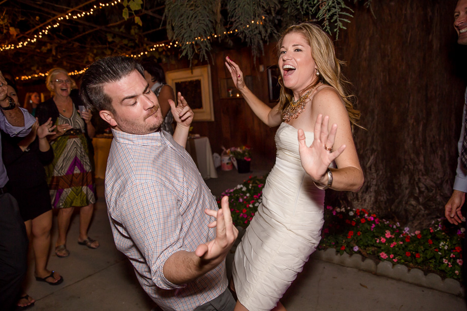bride dancing with her brother on the dance floor