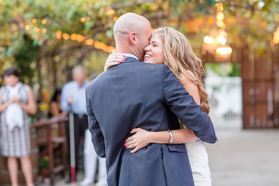 romantic outdoor first dance wedding photo at Coyote Ranch in San Jose with string lights