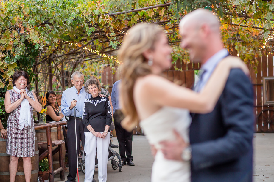 grandparents and parents reaction during newlyweds first dance was priceless - coyote ranch wedding