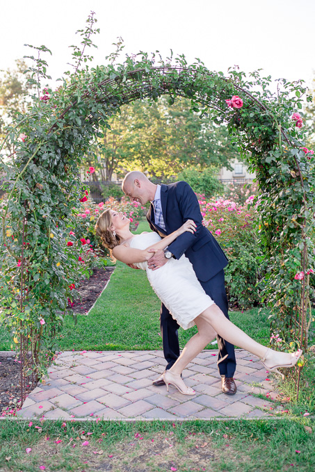 cute photo of the bride and groom in front of the wedding rose arch - san jose rose garden