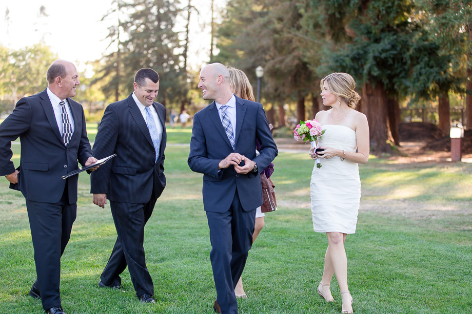 intimate wedding party walking in park