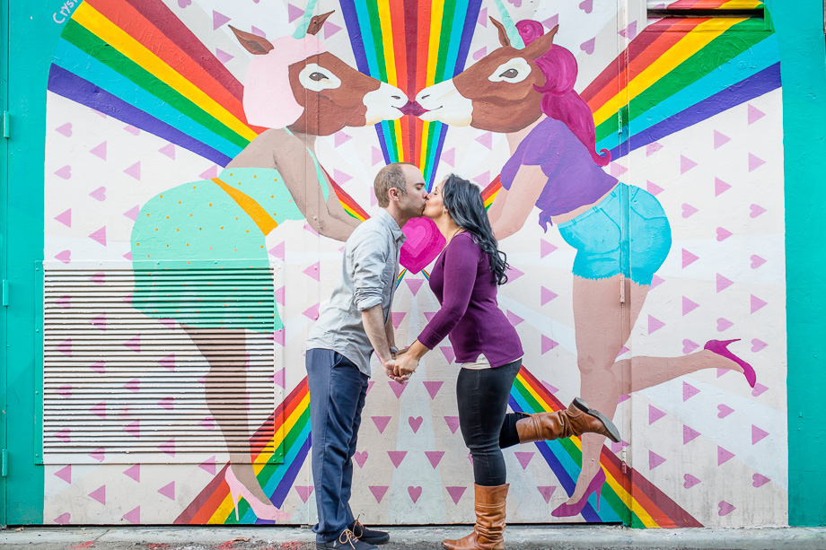 fun and colorful Clarion Alley graffiti wall engagement photo San Francisco demoncracy mural