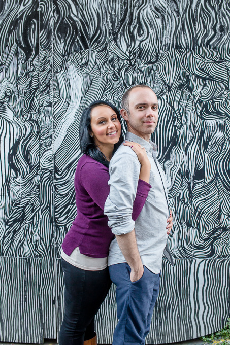 engagement photo in front of cool graffiti