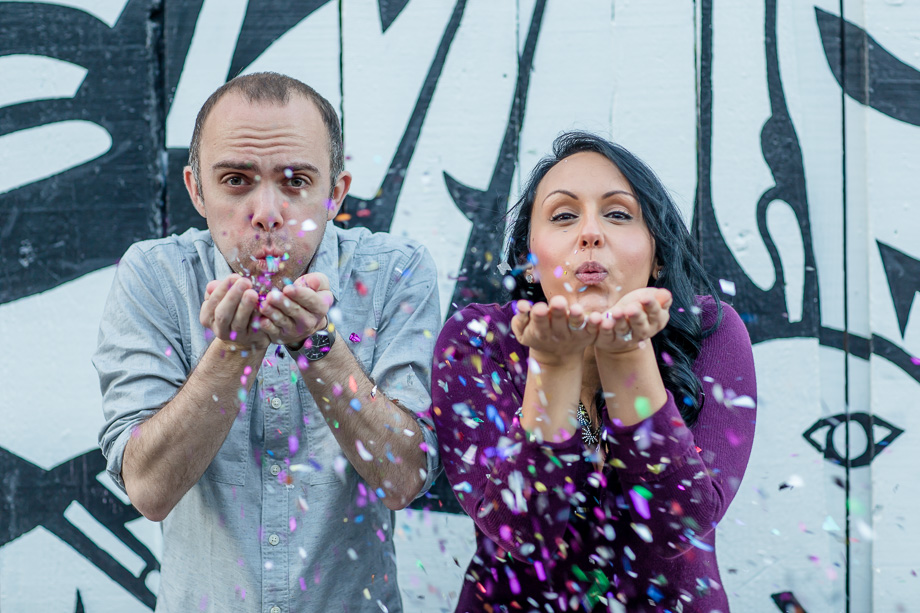 confetti engagement photo in front of the graffiti wall at san francisco clarion alley