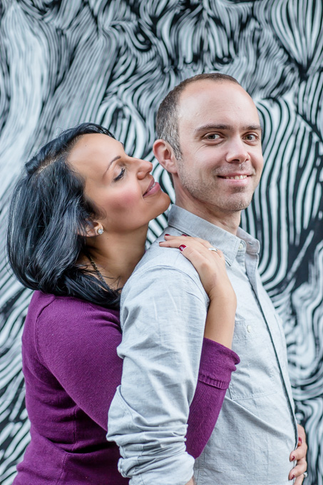 engagement photo in front of cool mural