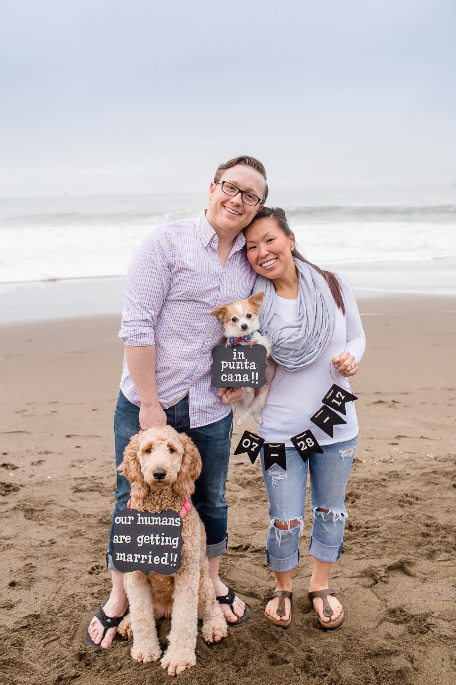 cute save the date photo at baker beach with two puppies