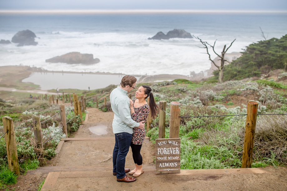 stunning save the date engagement photo at sutro baths - presidio engagement photographer