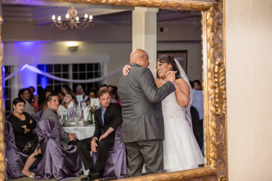 father daughter dance at wedding framed through a mirror