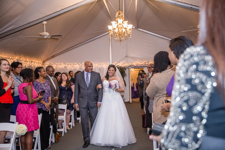 wedding ceremony under the wedding tent at grandview pavilion