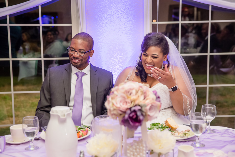 bride and groom laughing at guests funny speech - candid wedding photography