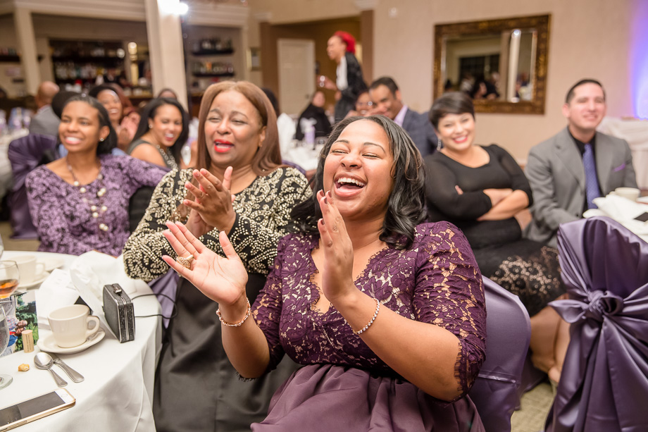 guests laughing at funny wedding toast