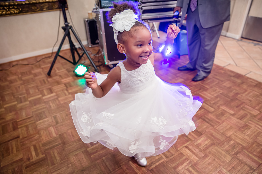 cute flower girl showing her dance moves at the wedding reception at grandview pavilion