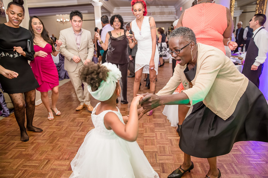 grandma dancing with little girl on wedding dance floor