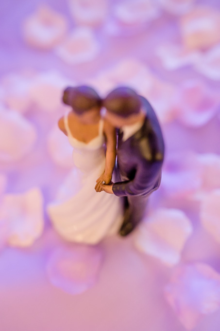 romantic wedding cake topper of couple holding hands