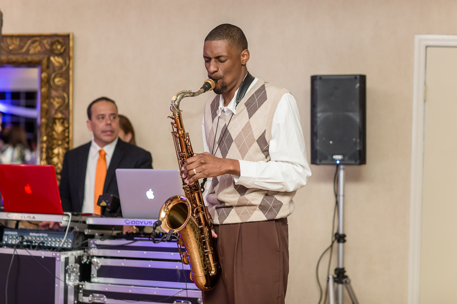 surprise saxophone performance during wedding reception