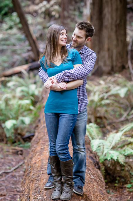 engagement photo on a fallen log