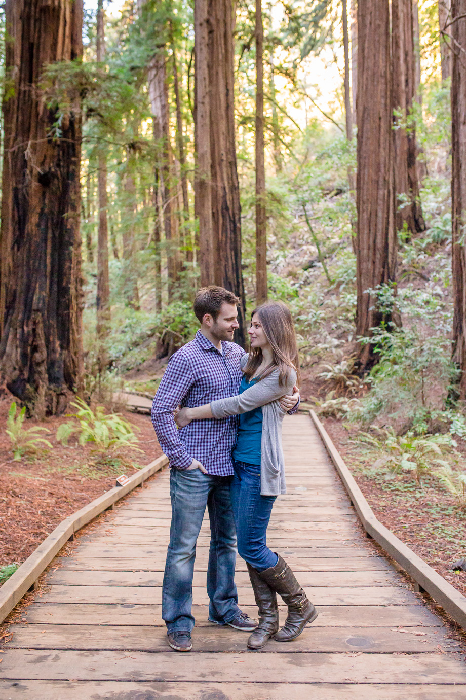 muir woods national park engagement photo on the hiking trail