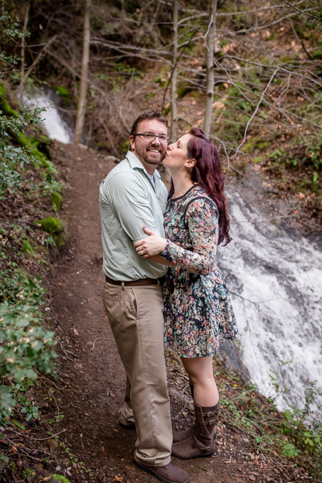 engagement photo next to small waterfall