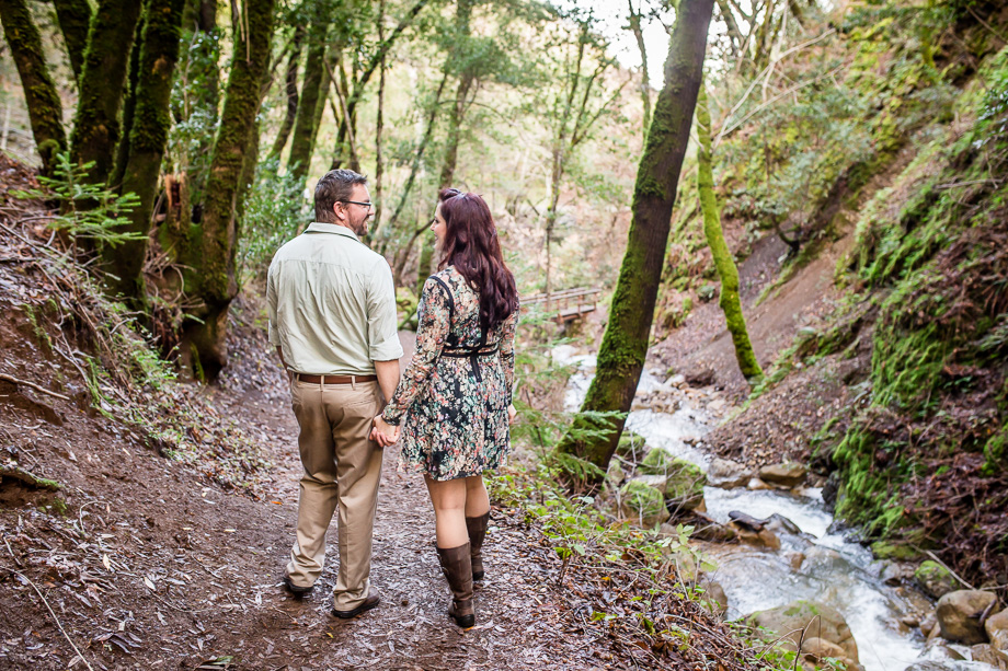 engagement photograph on hiking trail next to creek