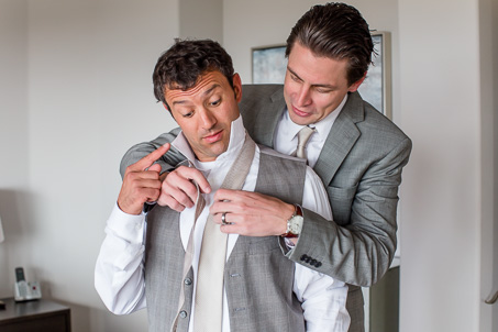 funny groom getting ready photo